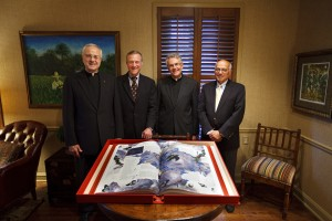 On hand for the presentation of The Saint John's Bible Heritage edition Aug. 27 were, left to right: St. Thomas president Father Dennis Dease; St. Thomas trustee Robert Ulrich, former chairman and chief executive officer of Target Corp.; Father Robert Koopmann, president of St. John's University; and John Pellegrene, retired executive vice president of marketing for Target Corp.