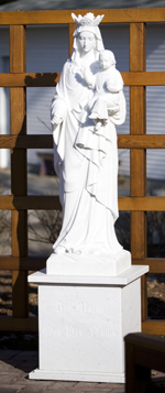 This marble statue of the Blessed Virgin Mary was recently carved in Italy and is now home in a landscaped terrace on the north side of Sitzmann Hall.