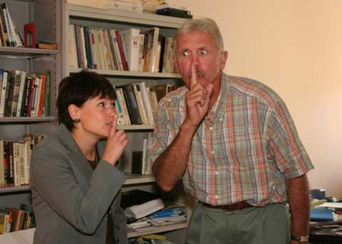 Two faculty members, Drs. Connery and Wyatt, are shushing rather than revealing the secret