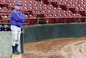 The coach, the leader, Dennis Denning surveys the scene of another Tommie basebal triumph.
