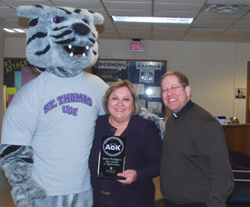 Dede Hering was presented the Acts of Kindness Award for January by Father Erich Rutten and Tommie.