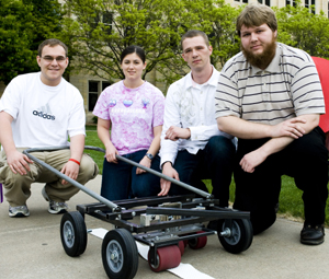 It's a lawn mower frame ... no wait. It's a pavement groove sensor. That's what it is.