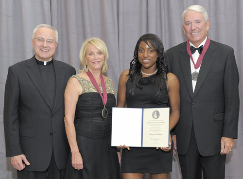Lee and Penny Anderson received a Saint Elizabeth Ann Seton Award from the National Catholic Education Association. Father Dennis Dease, president of St. Thomas, and Careese Coleman, a St. Thomas sophomore who received a scholarship in the Andersons' name, also attended the event.