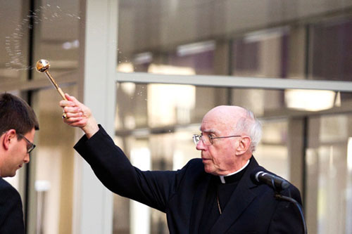 Archbishop Emeritus Harry Flynn blesses the Anderson Athletic and Recreation Complex at its dedication Wednesday.