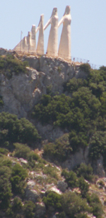 The Zalongo Monument sits atop a steep and rocky cliff in western Greece.