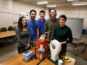 Students Anna Garin, Ahmed Abuabdullah, Kyle Biddle, Chris Cogan and Beth Langer with their water purification device.