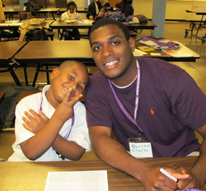 "St. Thomas student volunteer Darnell Clark with his ""reading buddy."""