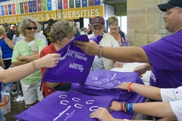 The iconic purple St. Thomas tote bags fly off the counter at designated times every day during the Minnesota State Fair. (Photo by Mark Jensen.)
