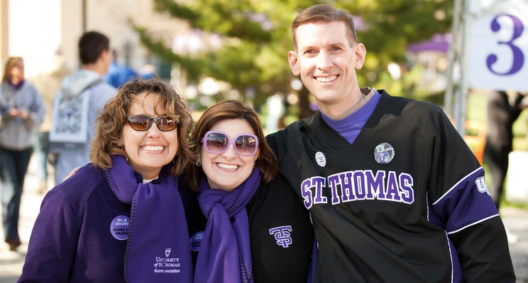 ACR employees Nadine Friederichs, Katie Spangler, and Phil Hoeppner pose for a photo during Taste of Saints on Saturday, October 15, 2012.