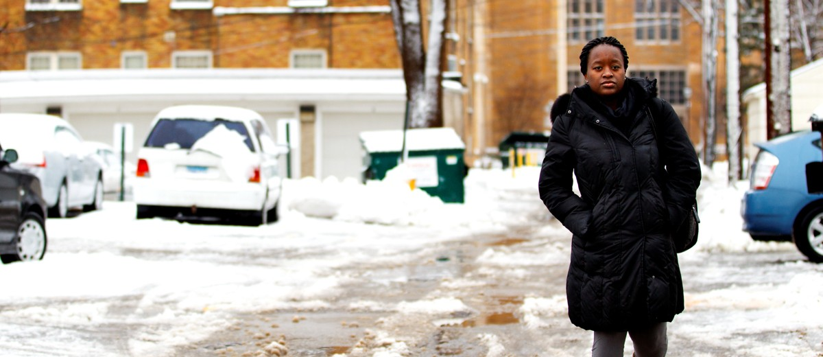 "Felista Mpanga heads to class on a slushy February morning. Her hometown of Kampala, Uganda, lies about three miles north of the equator and has an average temperature that holds close to 72 degrees year round. The average winter temperature in southern Minnesota is 16 degrees. ""I miss the weather most [from home],"" she said. ""I don't like the snow, and the summer is unbearably hot and humid here."""