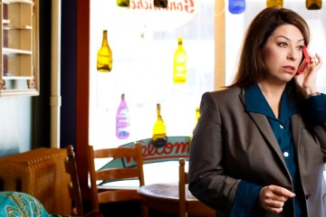 School of Law alum Stephanie Boucher (class of 2006) talks on her cell phone during a portrait session in The Edge coffee shop in Minneapolis April 20, 2012 for St. Thomas Lawyer magazine. Boucher works for the Minnesota Law Collective, a non-profit that provides legal services to people who cannot afford an attorney but do not qualify to be represented by a public defender.