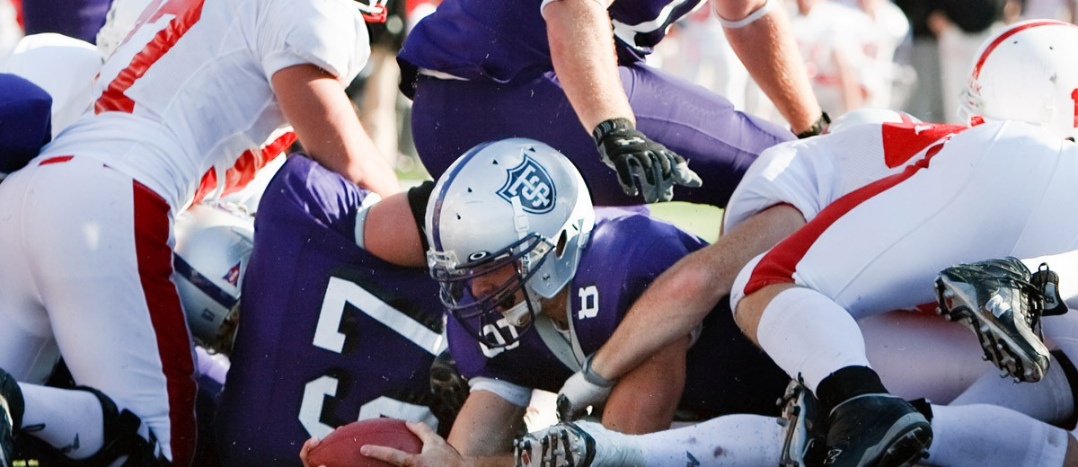 Running back Ben Wartman appeared to cross into the end zone in 2008, but game officials did not call it a score. The Tommies fumbled on the next play and Saint John's would go on to win 9-12. The losing streak would continue. (Photo by Mike Ekern '02)