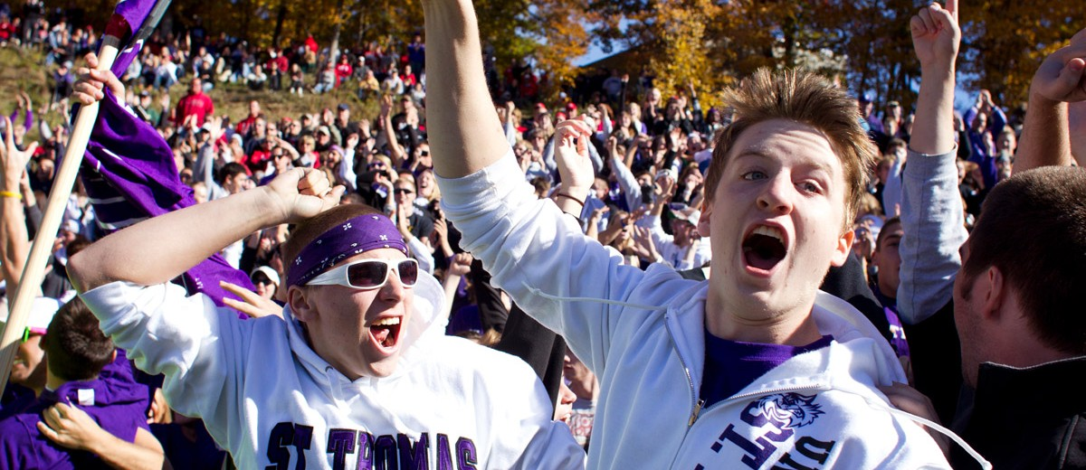 The 2010 Tommie crowd goes wild as St. Thomas snaps a 12-year losing streak with a 27-26 overtime victory. (Photo by Thomas Whisenand)