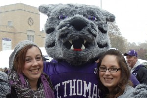 Sarah Pherson, left, gives Tommie a Homecoming hug with Christina Haubrich.