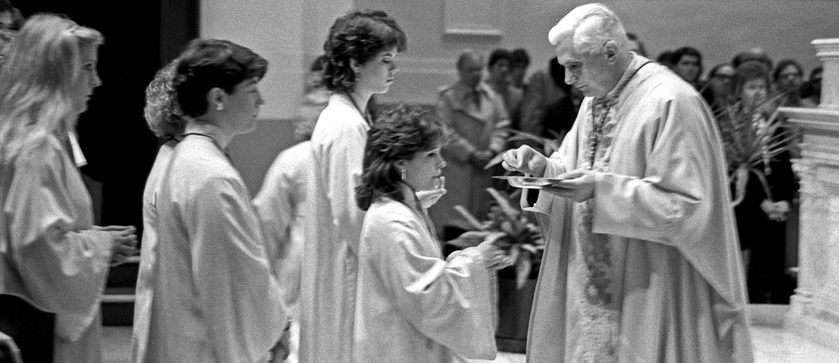 Cardinal Joseph Ratzinger, now Pope Benedict XVI, distributed communion at a Feb. 12, 1984 Mass in the Chapel of St. Thomas Aquinas.