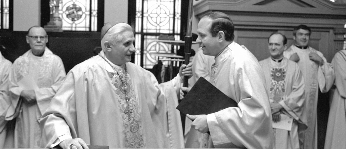 Then-Monsignor Richard Pates (right), now a bishop of the Archdiocese of Des Moines, visited with then-Cardinal Joseph Ratzinger in the sacristy of the Chapel of St. Thomas Aquinas on Feb. 12, 1984.