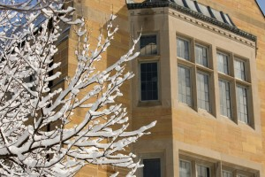 Aquinas Hall (AQU) is shown through snow-covered trees after a winter storm April 1, 2008.