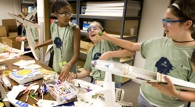 From the left, Jayla Mayes-Jackson, Kaitlin Nix and Katie Bruce have fun while building airplanes at an earlier STEPS camp (St. Thomas photo by Mike Ekern).
