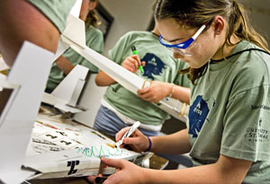 Maggie Graham decorates her airplane at an earlier STEPS camp (St. Thomas photo by Mike Ekern).