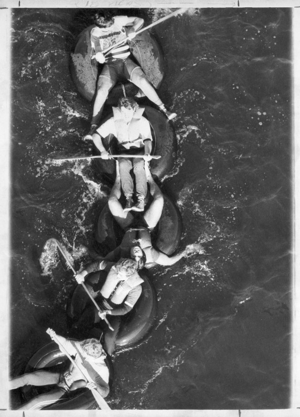 Raft races on the Mississippi River during homecoming at the College of St. Thomas, 1970. From the University Archives photo collection.