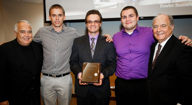 Left to right, Trustee Ron Fowler, student Blake Reid (Entrepreneurship), student Ethan Imdieke (Entrepreneurship), student Mason Perry (Entrepreneurship), and Opus College of Business Dean Christopher Puto are pictured at the Fowler Business Concept Challenge.