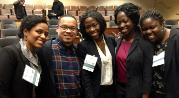 Congressman Ellison poses with UST MBA student ambassadors (from left) Metasebia Ayalew, Janet Namulondo, Nayila Yaro, and Nana Grace Kwapong.