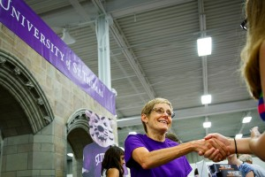 President Julie Sullivan greets a visitor at the university's Minnesota State Fair booth in August 2013.