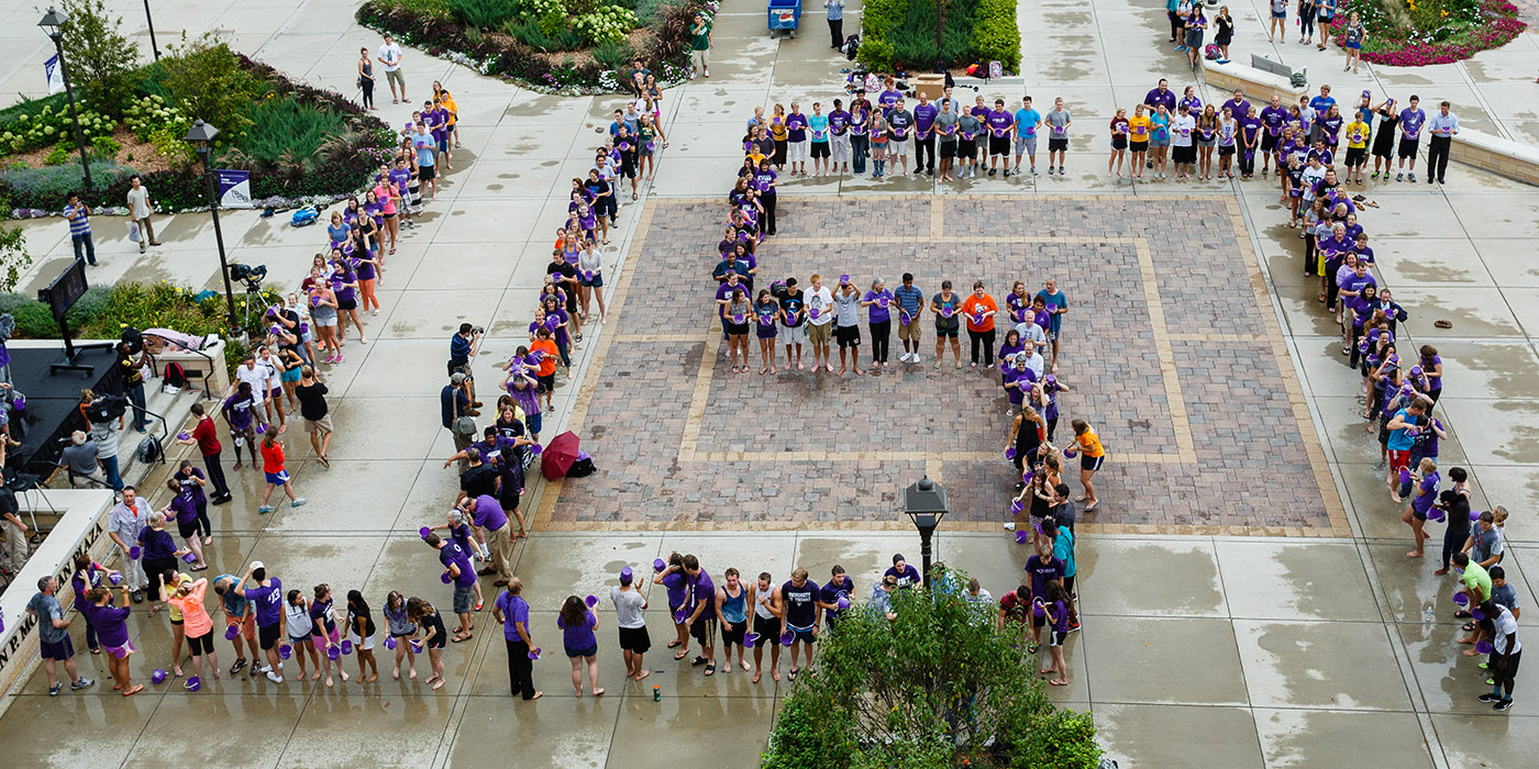 Students, staff and faculty, spelling out UST in giant letters, douse themselves with cold water during an ALS Ice Bucket Challenge event on John P. Monahan Plaza on Sept. 4, 2014.