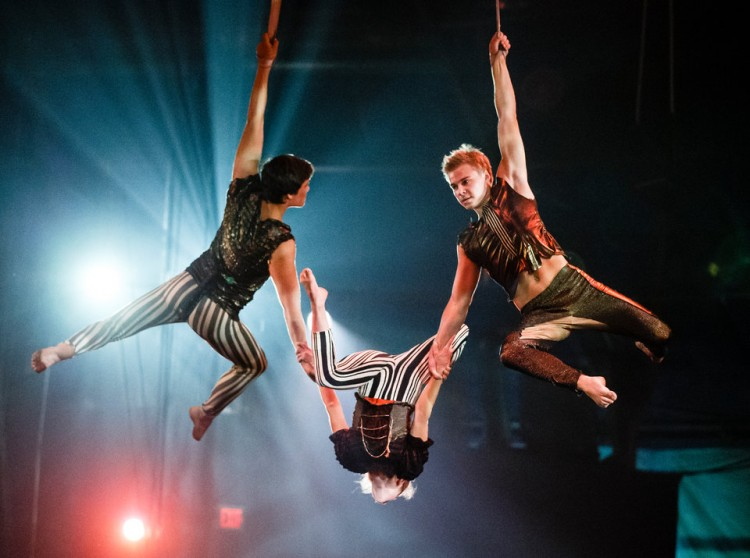 Dahlen (right) performs on the Straps high above the floor.