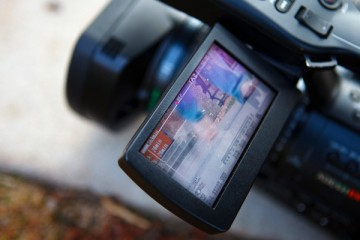 A close up of a TommieMedia video camera's LCD.
