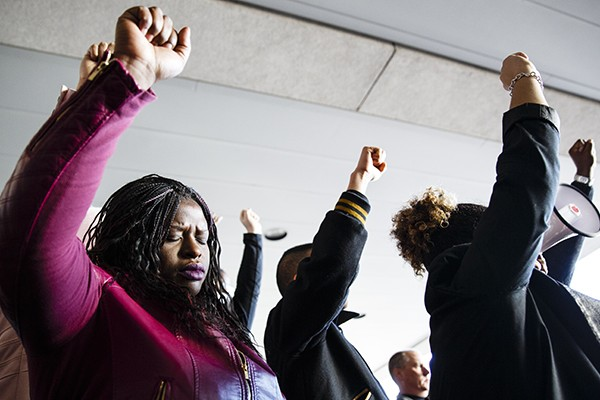 University of St. Thomas School of Law Professor Nekima Levy-Pounds (maroon jacket) is pictured after a court appearance at the Hennepin County District Court in Edina on March 10, 2015 with supporters from the Black Lives Matter organization. Levy-Pounds and other civil rights activists were protesting criminal trespassing charges brought against them by the county for a rally in December 2014 at the Mall of America.