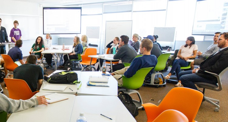 "Students give presentations in Professor Alec Johnson's  Foundations of Entrepreneurship class in a ""smart classroom"" in Schulze Hall 420 in downtown Minneapolis on April 14, 2015."