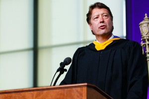 Archie Black, CEO of SPS Commerce, right, gives the commencement address during the graduate business commencement ceremony May 23, 2015 in the Anderson Athletic and Recreation Complex Field House.