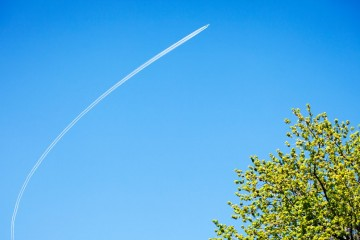 An airplane turns above the St. Paul campus of the University of St. Thomas on Wednesday, May 18, 2011.