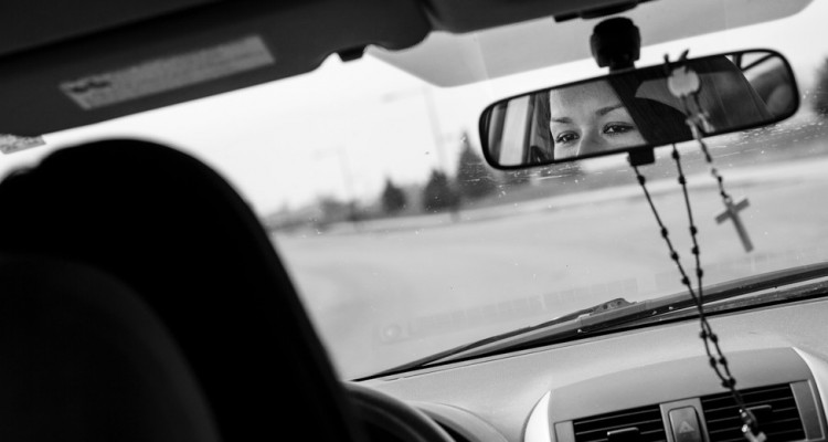 Alejandra Chavez Rivas is reflected in her rearview mirror. Chavez Rivas was profiled by St. Thomas magazine.