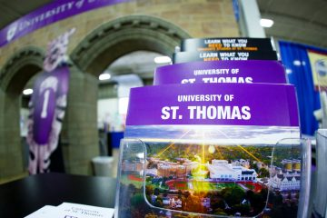 Promotional literature is shown at the university's Minnesota State Fair booth August 23, 2013. A pair of faux Arches is in the background.