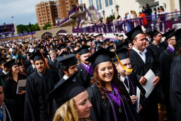 A student laughs as she leaves O'Shaughnessy Stadium during the undergraduate commencement ceremony May 23, 2015.
