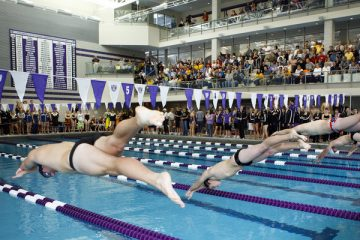 Men's swimming team members launch from the starting blocks during the Tommie Relays, the first intercollegiate meet in the new Anderson Athletic and Recreation Complex aquatic center October 30, 2010.