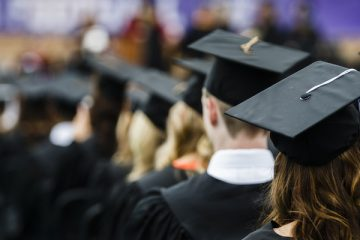 Mortarboards (caps) and tassels are shown during the undergraduate commencement ceremony May 23, 2015 in O'Shaughnessy stadium.