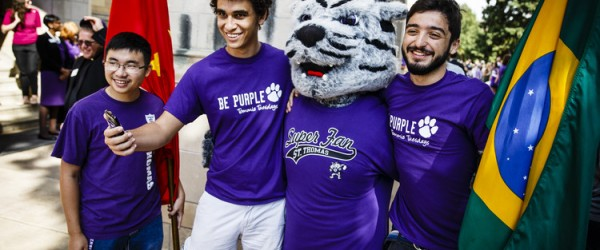 International students, including Gustavo Faria (second from left) and Diogo Placer (right) take a selfie photo with Tommie the Mascot before the March Through the Arches September 8, 2015. The march is an annual ceremony where incoming freshmen are welcomed to campus.