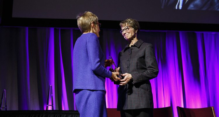 Lynn Casey ('85, MBA) receives the Entrepreneur Alumna of the Year Award from UST President Dr. Julie Sullivan, left, during the 2015 Entrepreneurship Awards gala in the Schulze Grand Atrium in the School of Law building in downtown Minneapolis on November 19, 2015. Casey is president of the Minneapolis-based communications agency PadillaCRT.