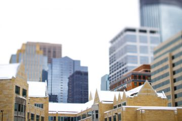 Terrence Murphy Hall (right) and Schulze Hall are covered in snow as the Minneapolis skyline looms in the background February 22, 2013.