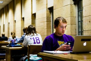 "Student Sam Barr studies in O'Shaughnessy-Frey Library May 18, 2015 during the finals week ""study Monday."""