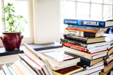 A large stack of books sit on shelves and the floor in Sociology and Criminal Justice Professor Lisa Waldner's office in the John R. Roach Center for the Liberal Arts on August 13, 2015. The books were temporarily stacked while awaiting new shelving. These images were taken for CAS Spotlight Magazine.