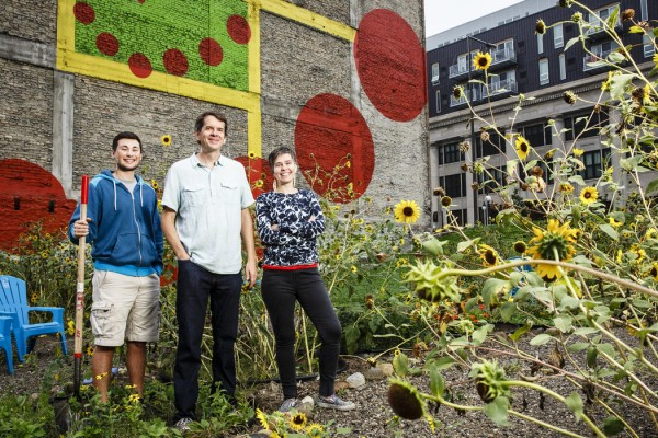 Left to right, Hunter Gaitan '15 (Biology), Biology Professor Adam Kay and Amanda Lovelee, St. Paul City Artist, pose for a portrait at the Urban Flower Field at Pedro Park at 10th and Robert Streets in downtown St. Paul on September 22, 2015. With the help of members of the downtown community, the project has planted 96 bio-diverse plots of flowers. University of St. Thomas researchers and students will use these plots to test whether more diverse flower plots are better able to extract harmful substances from the soil. The plots are arranged in a shape representing the golden mean, creating walking paths and a gathering space for programmed activities and neighborhood events.