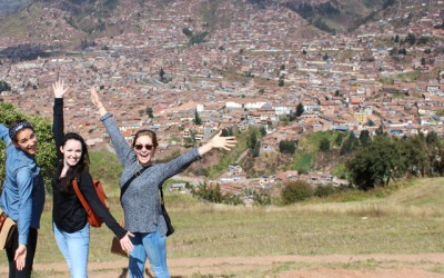 Rachel Weber, Erin Kern, and Hannah Tilstra posing above the city of Cusco. (Photos by Erin Kern)