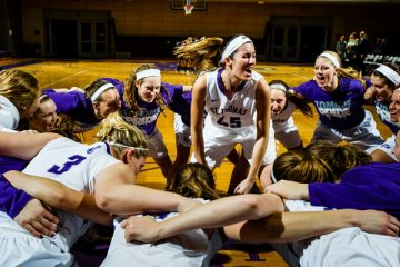 Kaitlin Langer and the Tommies psych up before a women's basketball game versus Gustavus Adolphus College.