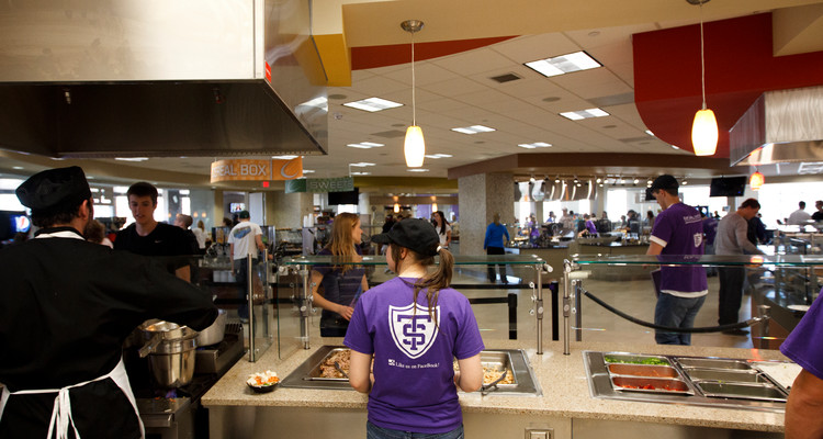 "Dining services employees work at the ""Your Call"" action station in The View dining area in the Anderson Student Center March 27, 2012 ."