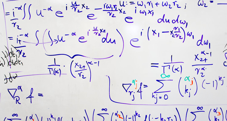 equations on whiteboard