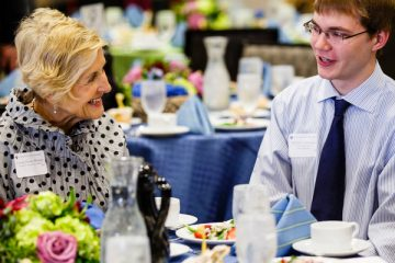 Student Matthew Anderson (right) chats with donor Joanne Hense during the Scholarship Spotlight Event May 7, 2015 in the Anderson Student Center's Woulfe Alumni Hall. The annual event brings together donors and scholarship recipients for a lunch and program.